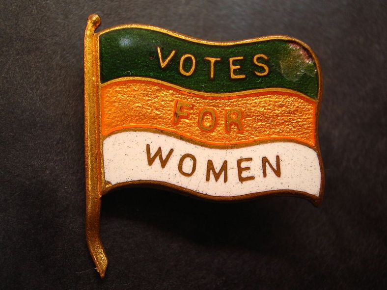 800px-Votes_for_Women_lapel_pin_(Nancy)